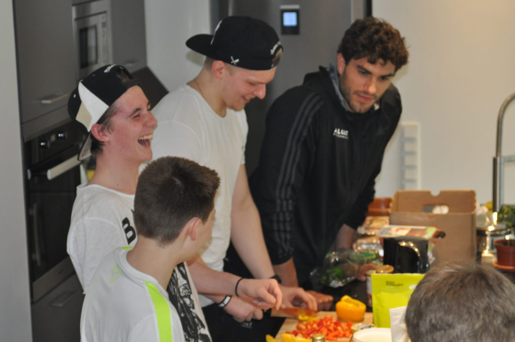 Athletes preparing food